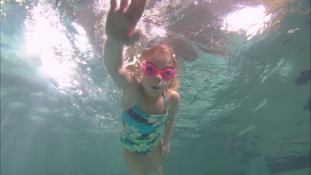 la ms girl swimming toward camera underwater in pool / riverhead, new york, usa - swimwear stock videos & royalty-free footage