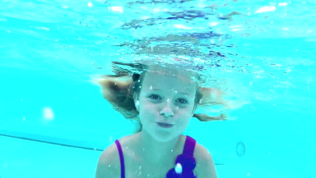 girl swimming underwater toward camera - one girl only stock videos & royalty-free footage