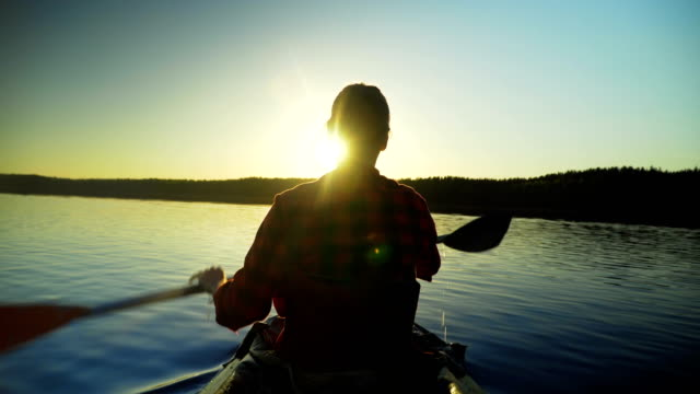 girl swims in the kayak in the sunset - kayaking stock videos & royalty-free footage
