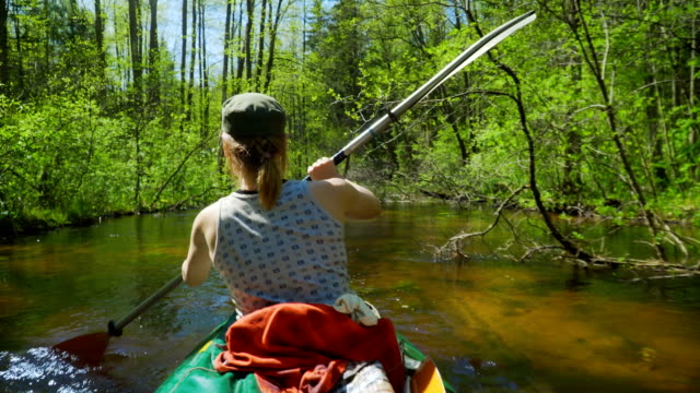 girl swims in the kayak - canoeing stock videos & royalty-free footage