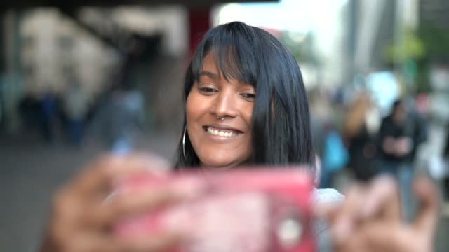girl taking a selfie in the city - belém brazil stock videos and b-roll footage