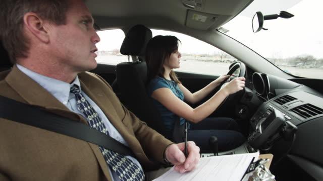 vídeos de stock, filmes e b-roll de ms girl (16-17) taking driving test, instructor writing in clipboard / orem, utah, usa - orem utah