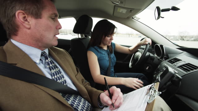 vídeos de stock, filmes e b-roll de ms girl (16-17) taking driving test / orem, utah, usa - orem utah