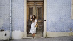 Girl taking selfie near door and wall with abstract pattern