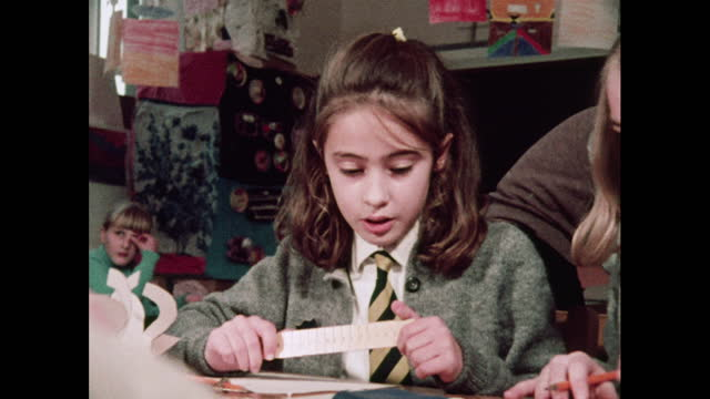 girl talks whilst completing schoolwork, 1970s - pencil stock videos & royalty-free footage