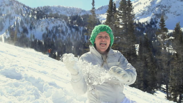 stockvideo's en b-roll-footage met ms girl (10-11) throwing snow at camera / alta, utah, usa - alta utah