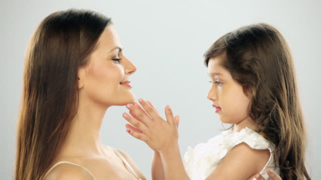 Girl touching face of her mother
