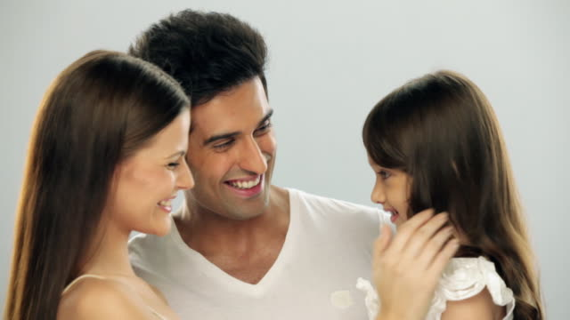 Girl touching face of her parents