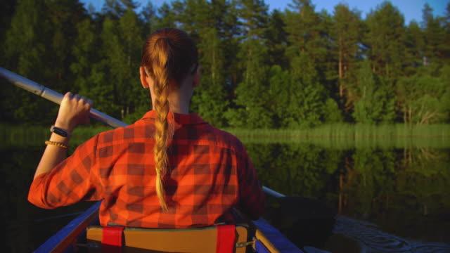 girl traveler swims in kayak on lake - kayak stock videos & royalty-free footage