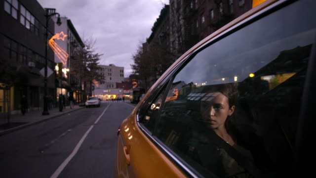 Girl traveling through New York in a cab