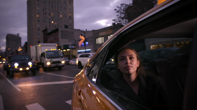 girl traveling through new york in a cab - taxi stock videos & royalty-free footage