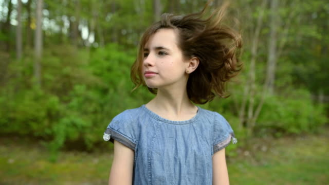 girl turning head with wind blowing her hair - following stock videos & royalty-free footage