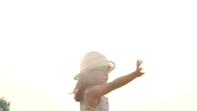 girl twirling in the grass in sunset. - one girl only stock videos & royalty-free footage