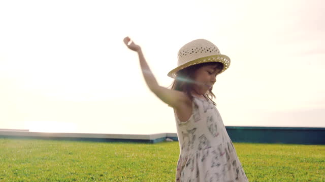 girl twirling in the grass in sunset. - children only stock videos & royalty-free footage