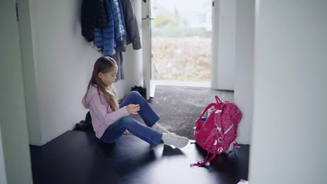 girl tying shoes - one girl only stock videos & royalty-free footage