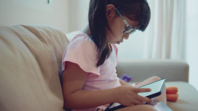 girl typing on tablet - girl cross legged stock videos & royalty-free footage