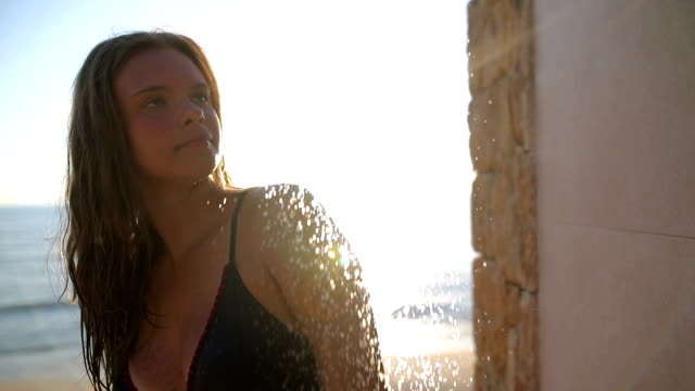 girl under the shower in the sunset - bikini stock videos & royalty-free footage
