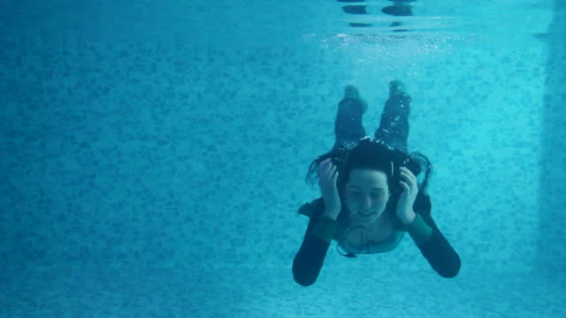 girl underwater listening music - headphones stock videos & royalty-free footage