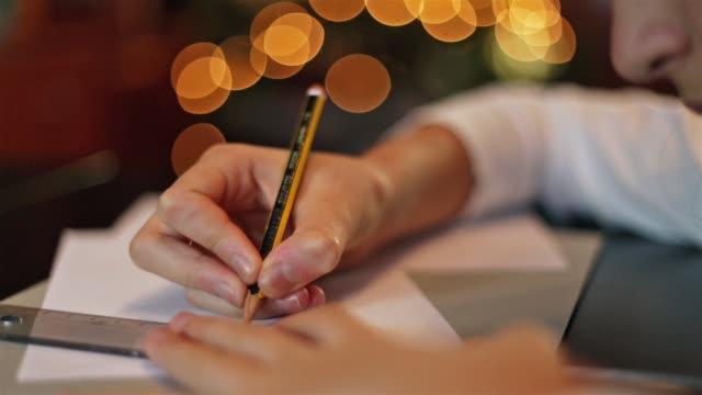 girl using a pencil and a ruler. - parte de una serie video stock e b–roll