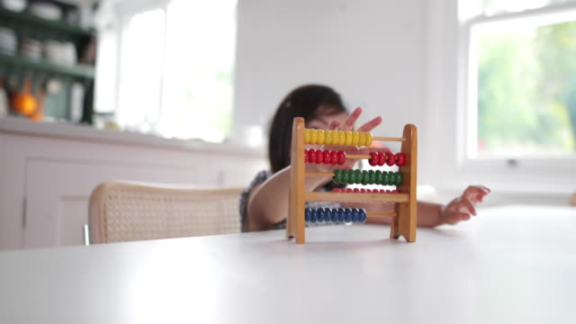 Girl using abacus to count