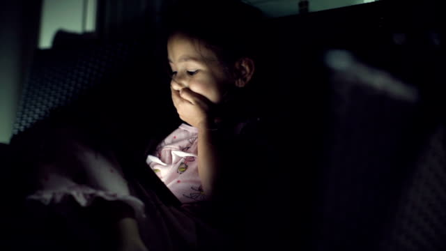 A girl using digital tablet at home