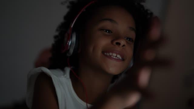 girl using digital tablet in the bedroom - pardo brazilian stock videos & royalty-free footage