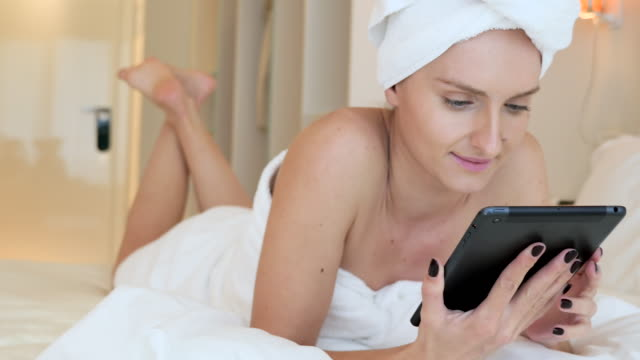 girl using digital tablet - wearing a towel stock videos and b-roll footage