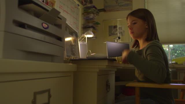 MS, PAN, Girl (10-11) using laptop at home, Hollywood, California, USA