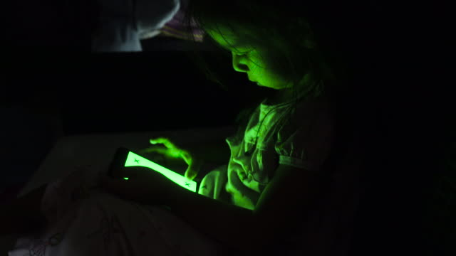 girl using smart phone with green screen on sofa - touchpad stock videos & royalty-free footage
