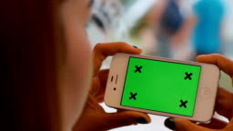 Girl Using smart phone with Green Screen