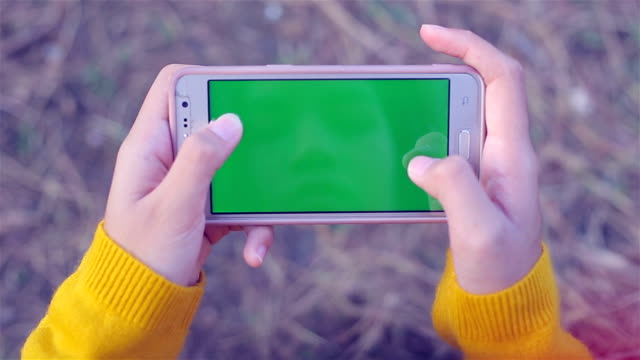 Girl using smartphone ,Green screen