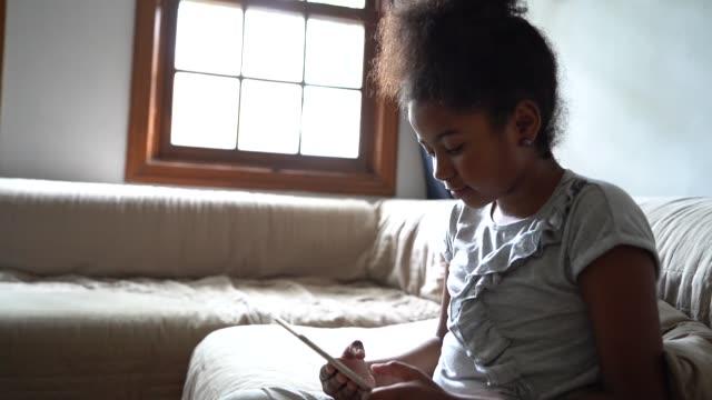 girl using tablet at sofa - pardo brazilian stock videos & royalty-free footage
