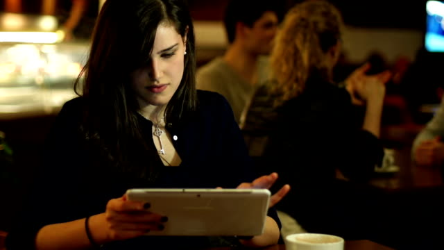 girl using tablet in coffee shop /internet cafe - coffee drink stock videos and b-roll footage