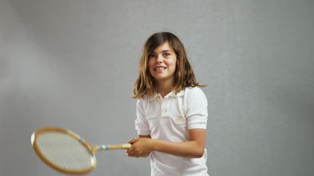 girl using tennis racket - tennis racket stock videos & royalty-free footage