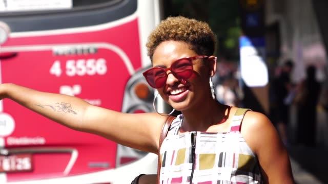 girl waiting for a bus - rio de janeiro stock videos & royalty-free footage