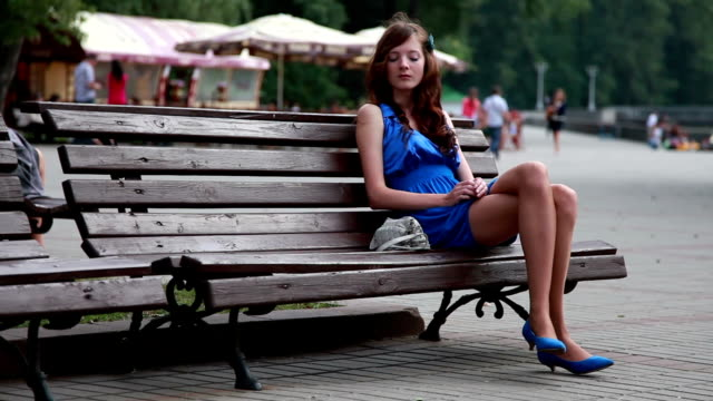 Girl Waiting For A Date In Park