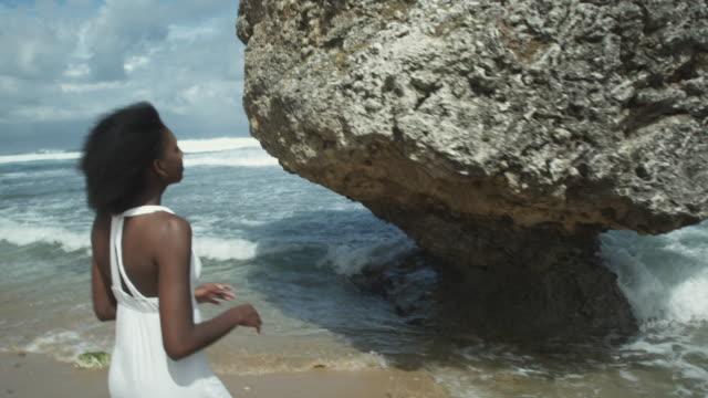 ms tu td girl (14-15) walking along beach and in water, atlantic shores, bridgetown, barbados - walking in water stock videos & royalty-free footage