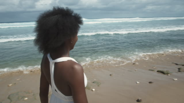 ms girl (14-15) walking along beach and in water, atlantic shores, bridgetown, barbados - one teenage girl only stock videos & royalty-free footage