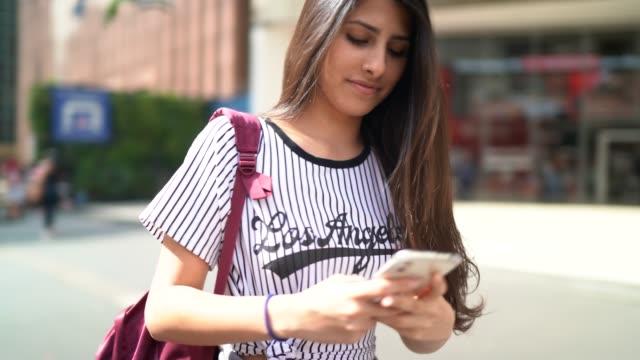 girl walking and using smartphone at city - avenida paulista stock videos & royalty-free footage