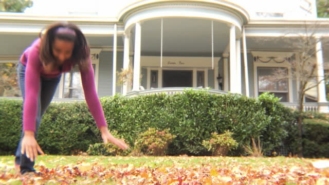 MS Girl (12-13) walking on hands in yard / Montclair, New Jersey, USA