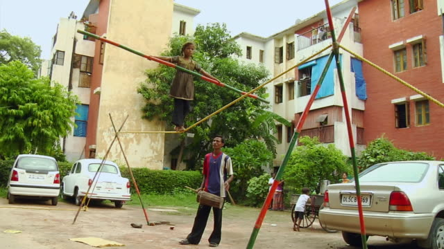 WS LA Girl walking over tightrope / Delhi, India