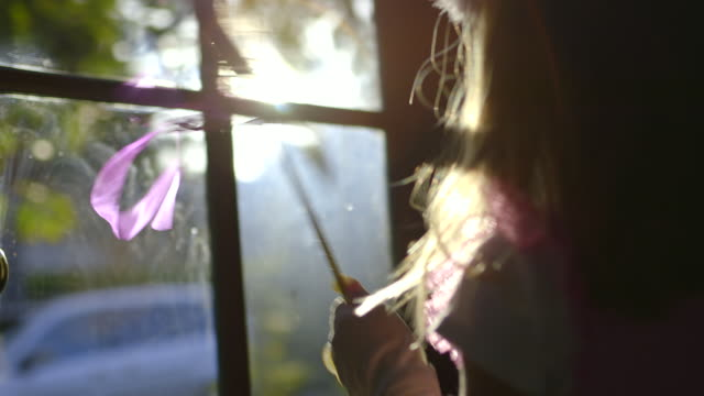 cu pov r/f girl walking to window for saying goodbye to dad / los angeles, california, united states - winken stock-videos und b-roll-filmmaterial