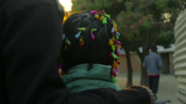 girl walking with adult in angola - braided hair stock videos & royalty-free footage