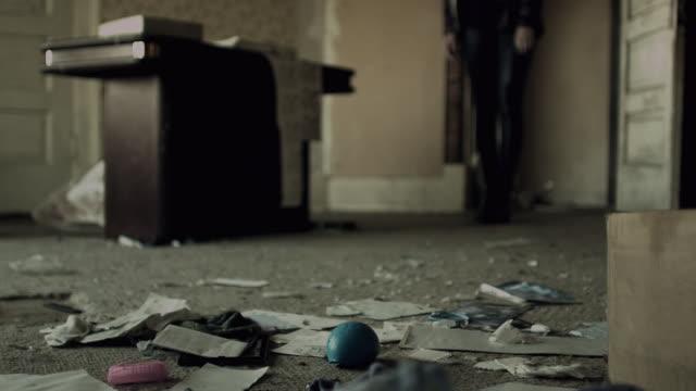 Girl Walks through door into room in an abandoned home.
