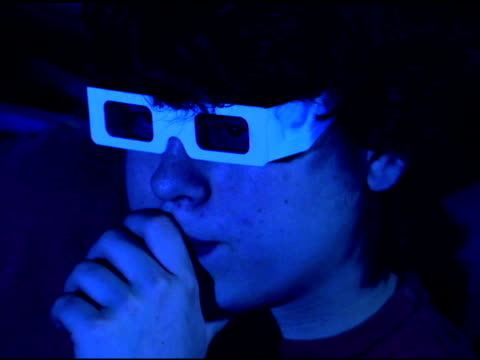 girl watching 3-d movie in theater - one teenage boy only stock videos & royalty-free footage