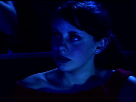 girl watching scary movie in theater - biosalong bildbanksvideor och videomaterial från bakom kulisserna
