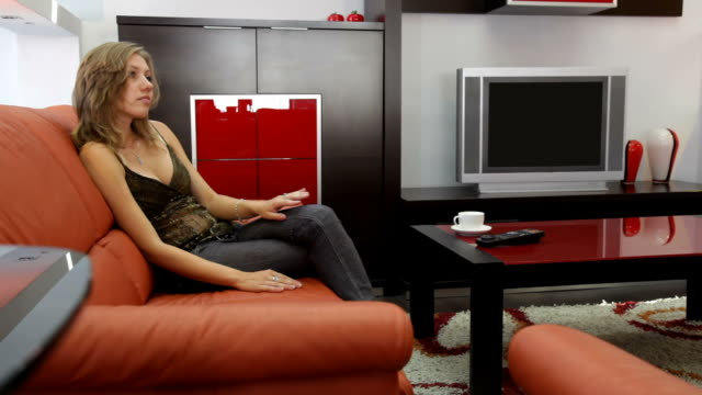 girl watching tv in the living room - tidy room stock videos & royalty-free footage