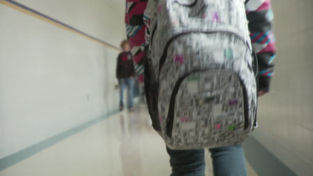 cu ts girl (14-15) wearing backpack walking along school corridor, cazenovia, new york, usa - rucksack stock videos & royalty-free footage