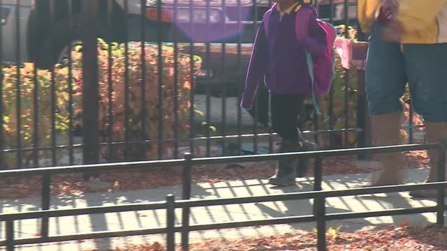 WGN Girl Wearing Backpack Walking Into School With Mother in Chicago on November 9 2015