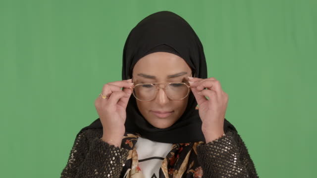 girl wearing hijab chroma wearing eyeglasses - modest clothing stock videos & royalty-free footage